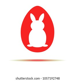 picture Easter Bunny on a red background, red egg for the holiday Pasco, game for children, sticker for home decor for the holiday.