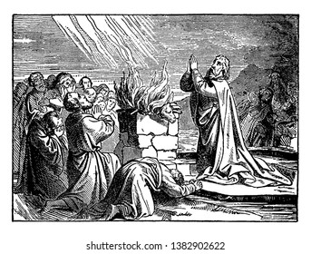 In the picture Elijah and some people are kneeled down before the altar and praising the god. The altar has a bull on top of it and it is on fire, vintage line drawing or engraving illustration.