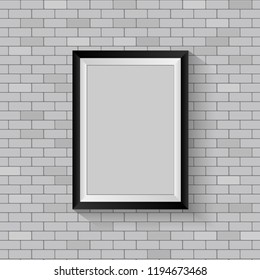 Picture frame on gray brick wall