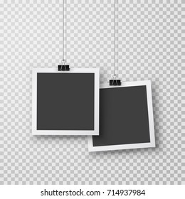 Picture frames with shadow hanging with paper clip. Black square snapshots and metal blinder isolated on transparent background. Vector silver paperclip on  photo for your design