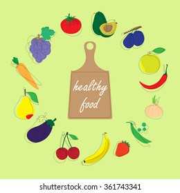 Picture of fruits and vegetables. Healthy eating on a green background next to a cutting board.