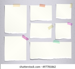 Pieces of beige ripped note, notebook paper sheets with colorful adhesive, sticky tape stuck on grey background