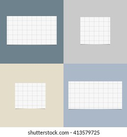 Pieces of cut white squared notebook paper with shadow are stuck on colorful background. - Shutterstock ID 413579725