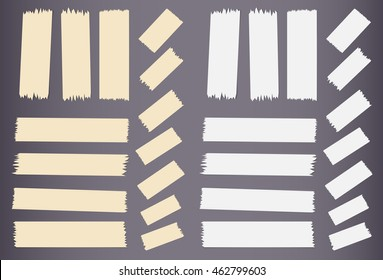 Pieces of different size sticky, adhesive masking tape.