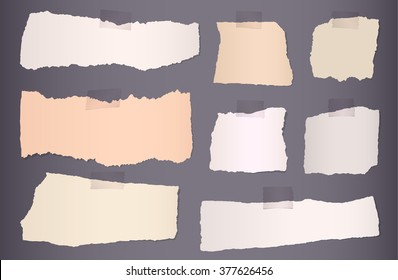 Pieces of torn colorful blank paper on dark background