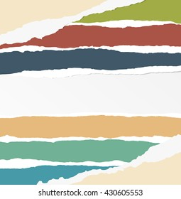 Pieces of torn colorful blank paper are stuck on gray background.