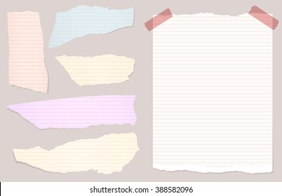 Pieces of torn colorful lined notebook, note paper