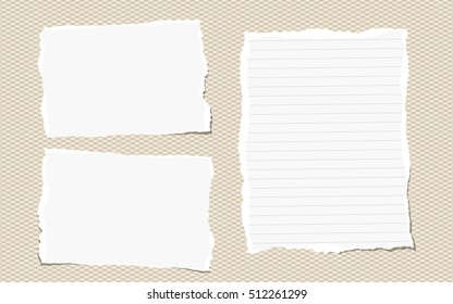 Pieces of white torn note, notebook paper sheets stuck on brown background