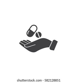 Pill in the hand icon. Health Care Vector illustration