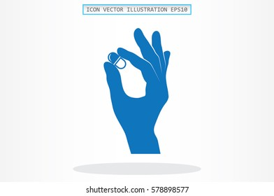 Pill in the hand icon vector illustration.