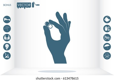 Pill in the hand icon vector illustration eps10.