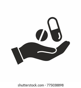 Pills in hand icon