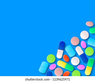 Pills, tablets and capsules in the lower right corner on a blue background. Pharmaceutical medicine concept.