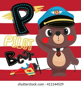 Pilot teddy bear with toy airplane on red and white lined background.