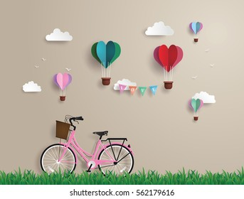 Pink bikes parked on the grass with heart shaped balloons  floating on the sky.paper art and  digital craft style.