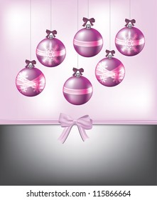 Pink Christmas card width ornaments and bows.