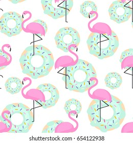 Pink flamingos and donuts trendy seamless pattern on white background. Exotic art background. Design for fabric, wallpaper, textile and decor.