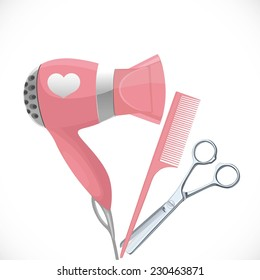 Pink hair dryer with concentrator, scissors and comb isolated on a white background