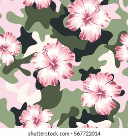 Pink hibiscus flowers and on the camouflage background. Vector seamless pattern. Tropical summer illustration.
