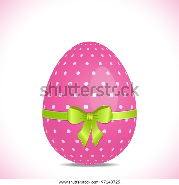 Pink polka dot easter egg with green ribbon