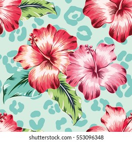Pink and red hibiscuses with green leaves on the leopard skin print background. Vector seamless pattern with tropical flowers.