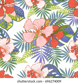 Pink and red tropical hibiscus and palm leaves vector seamless pattern. Floral summer background.