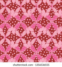 pink and red vivid floral seamless pattern tile with detailed floral decoration and butterflies over polka dots texture for textile, fabric, wallpaper, backdrops, backgrounds. the tile is seamless.