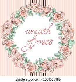 Pink roses in a round wreath.
