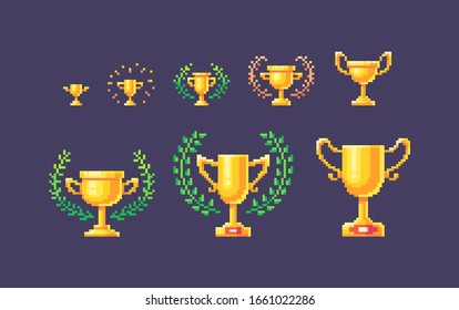 Pixel art set of gold winner cups different forms and sizes. Vector illustration.