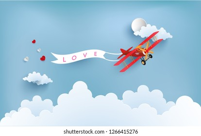 the plane carries the love that is spread. there are love writing banners.