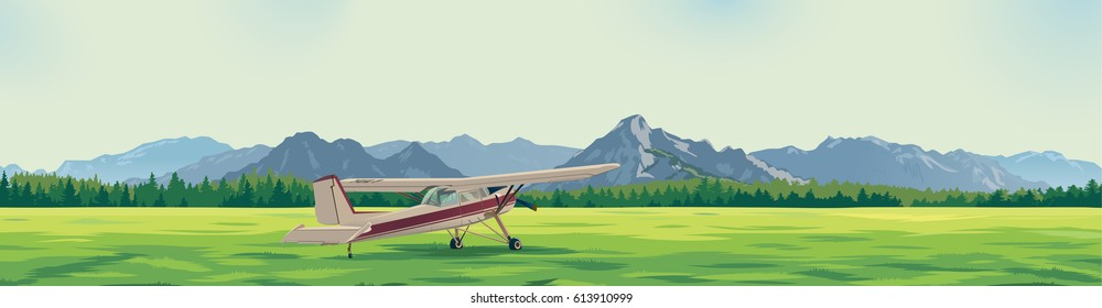 the plane standing on a glade against the background of mountains