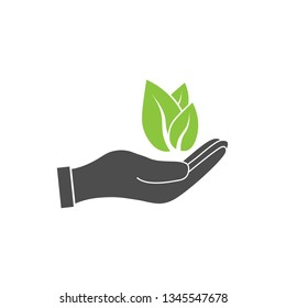 Plant leaf in hand icon. Vector illustration, flat design.