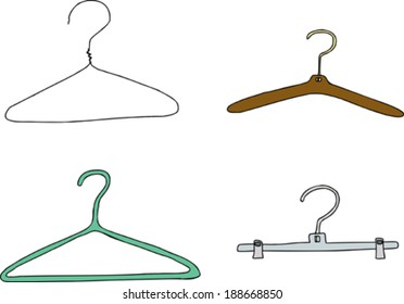 Plastic, metal and wooden clothes hangers over white background