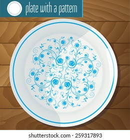 plate with blue pattern on a wooden table