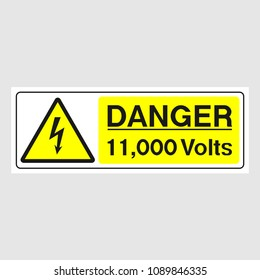 """Plate: """"Danger. 11,000 Volts""""(Panoramic sign). Sign: """"Danger. 11,000 Volts""""(Panoramic sign) on a gray background"""