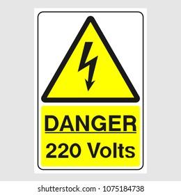 "Plate: ""Danger. 220 Volts"". Sign: ""Danger. 220 Volts"" on a gray background"