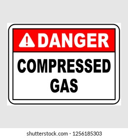 "Plate: ""Danger. Compressed Gas"". Sign: ""Danger. Compressed Gas"" on a gray background"