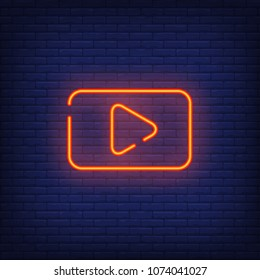 Play button neon sign. Red rectangle with play button. Night bright advertisement. Vector illustration in neon style for media and video