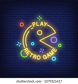 Play Retro Game lettering with pacman sign on brick background. Neon banner. Videogame,