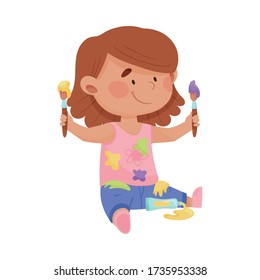 Playful Girl in Stained Clothes Sitting and Holding Paintbrushes and Paints Vector Illustration