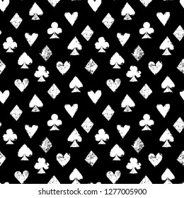 Playing cards different suits - hearts, diamonds, spades and clubs - black and white grunge seamless pattern, vector
