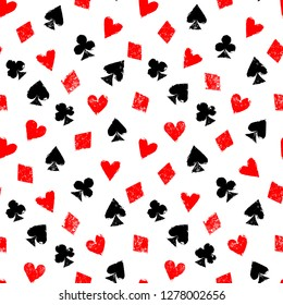 Playing cards different suits - hearts, diamonds, spades and clubs - grunge seamless pattern, vector