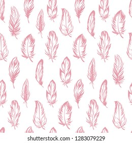 Plumage seamless pattern. Vector isolated plume on white background. Pink feathers. Fabric and clothes design, wallpaper, scrapbooking, stamping, bed linen. Candlelight peach color Pantone 2019.