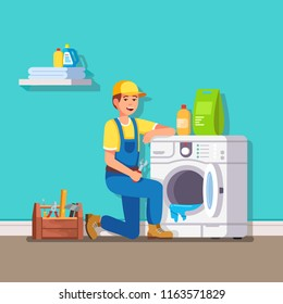 Plumber is fixing the washing machine. Modern flat style thin line vector illustration isolated on blue background.