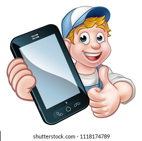 A plumber, mechanic or handyman holding a  phone with copyspace and giving thumbs up