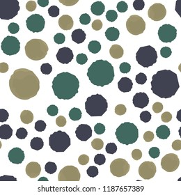Points in of dark yellow, grayish blue, desaturated cyan. Seamless Pattern. For your design. Vector.