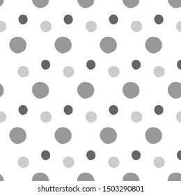 Polka dot gray shades, cheerful on a white background. Seamless vector pattern. For textile, surface packaging, packaging design.