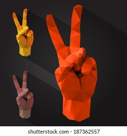 Polygonal style victory sign on a dark background