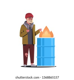 poor bearded man warming his hands by fire beggar guy standing near burning garbage in barrel homeless jobless concept white background full length