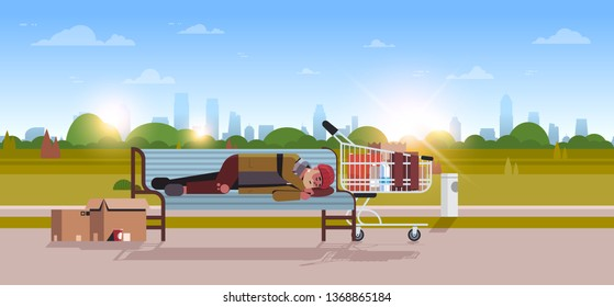 poor man sleeping outdoor drunk beggar lying on wooden bench homeless concept city park landscape sunrise background horizontal full length